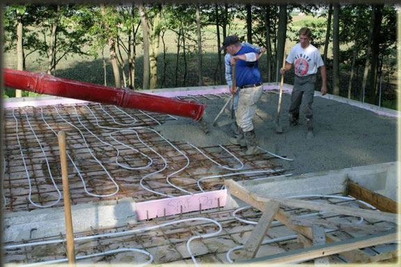 Country creek log homes construction gallery for How to pour a concrete slab for a garage